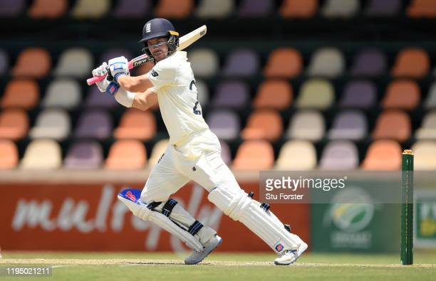 England batsman Rory Burns cuts a ball to the boundary during day one of the 3 day practice match between South Africa A and England at Willowmoore...