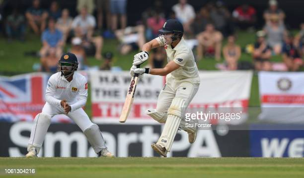 England batsman Rory Burns drives during Day One of the Second Test match between Sri Lanka and England at Pallekele Cricket Stadium on November 10...