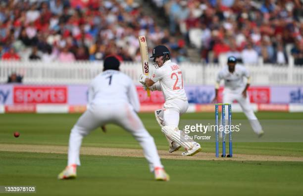 England batsman Rory Burns drives to the boundary on Ruth Strauss Foundation Day during day two of the Second Test Match between England and India at...