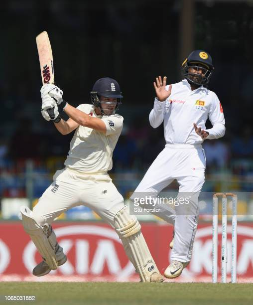 England batsman Rory Burns hits out past fielder Kaushal Silva during Day Three of the Third Test match between Sri Lanka and England at Sinhalese...