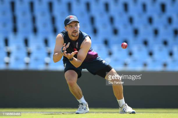 England batsman Rory Burns in catching action during an England nets session ahead of the First Test Match against South Africa at SuperSport Park on...