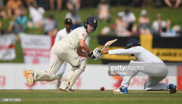 England batsman Rory Burns picks up a run during Day One of the Second Test match between Sri Lanka and England at Pallekele Cricket Stadium on...