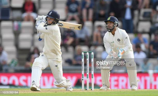 England batsman Sam Curran hits a six to reach his half century watched by India keeper Rishabh Pant during day one of the 4th Specsavers Test Match...