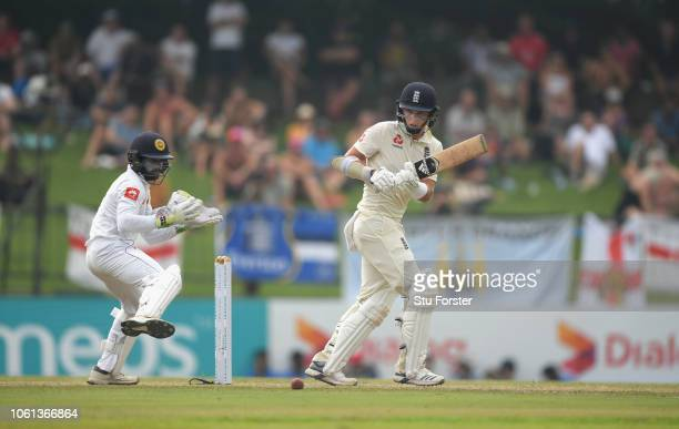 England batsman Sam Curran hits out as Niroshan Dickwella looks on during Day One of the Second Test match between Sri Lanka and England at Pallekele...