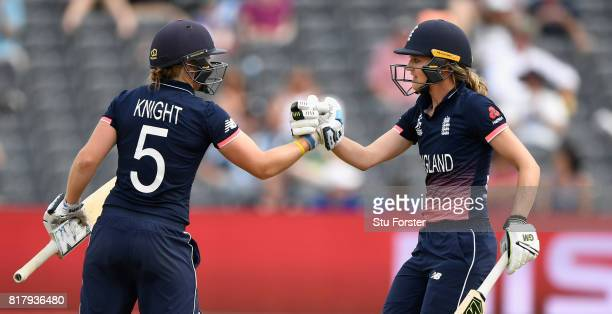 England batsman Sarah Taylor is congratulated on her half century by Heather Knight during the ICC Women's World Cup 2017 SemiFinal between England...