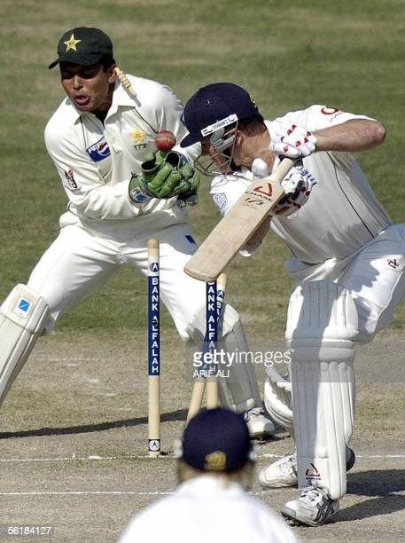 England batsman Shaun Udal is bowled out by leg spinner Danish Kaneria during the final day of the first Test match against England in Multan Cricket...