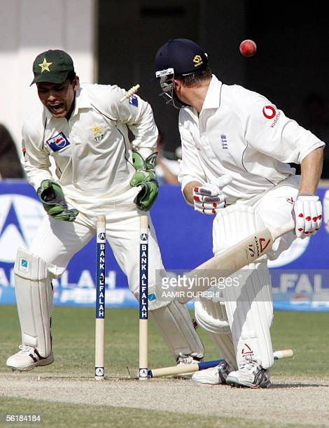 England batsman Shaun Udal is bowled out by Pakistani leg spinner Danish Kaneria as wicketkeeper Kamran Akmal reacts during the fifth and last day of...