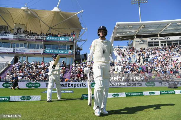 England batsman Stuart Broad and Sam Curran come out to bat during the 4th Specsavers Test Match between England and India at The Ageas Bowl on...