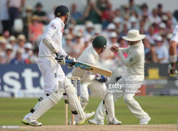 England batsman Stuart Broad is caught by Australia captain Michael Clarke but its not given by umpire Aleem Dar during day three of the First...