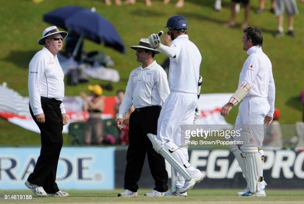 England batsman Stuart Broad talks with umpires Steve Davis and Aleem Dar after Broad was given out on referral to the third umpire during the 1st...