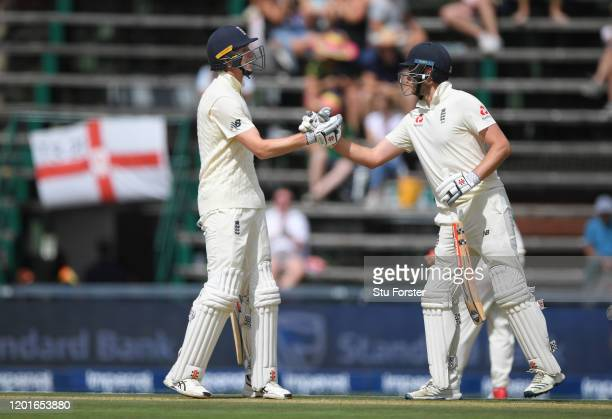 England batsman Zac Crawley celebrates his maiden half century with Dom Sibley during Day One of the Fourth Test between South Africa and England at...