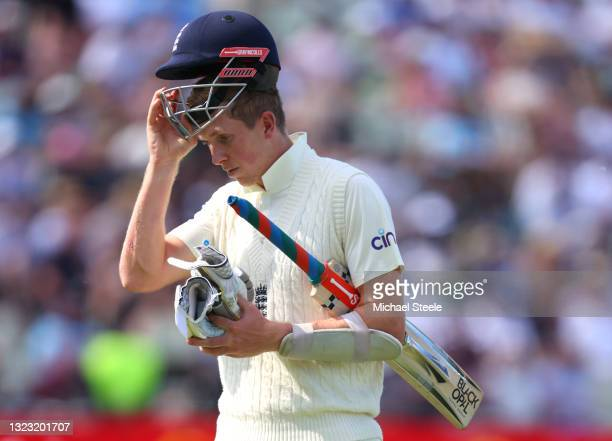 England batsman Zak Crawley walks off dejectedly after being dismissed by Matt Henry for 17 runs during day three of the second LV= Insurance Test...