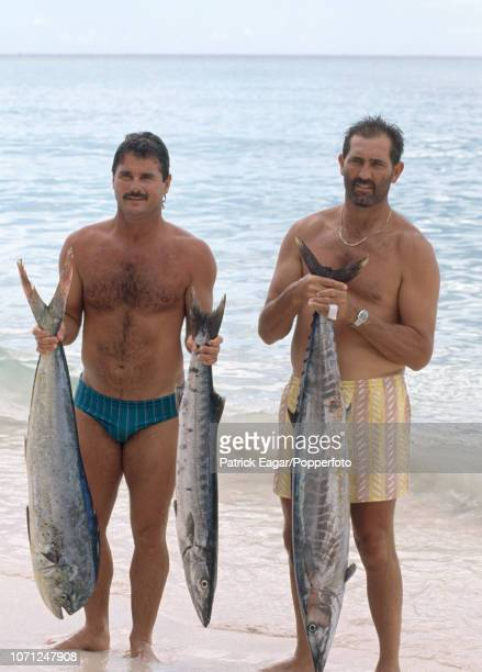 England batsmen Allan Lamb and Graham Gooch pose with the catch of the day during the rest day of the 4th Test match between West Indies and England...