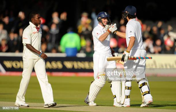 England batsmen Andrew Strauss and Alastair Cook celebrate after scoring the winning runs of the 1st Test match between England and West Indies at...