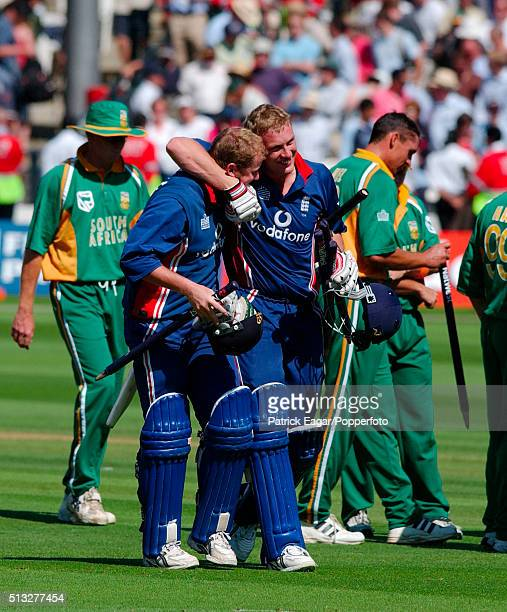 England batsmen Anthony McGrath and Andrew Flintoff walk off at end of the NatWest Series Final One Day International between England and South...