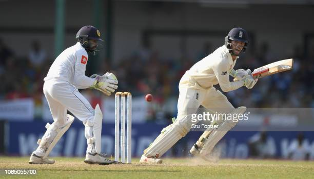 England batsmen Ben Foakes hits out watched by Sri lanka keeper Niroshan Dickwella during Day Three of the Third Test match between Sri Lanka and...