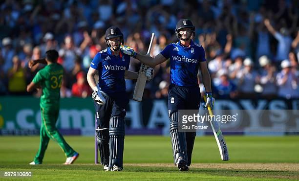 England batsmen Eoin Morgan and Jos Buttler congratulate each other after England had scored a World Record 444 runs for a One day international...