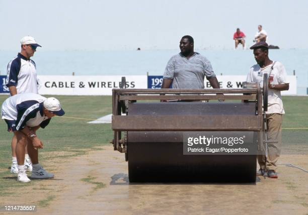 England batsmen Graham Thorpe and Alec Stewart examine the pitch as the heavy roller is used the day before the 1st Test match between West Indies...