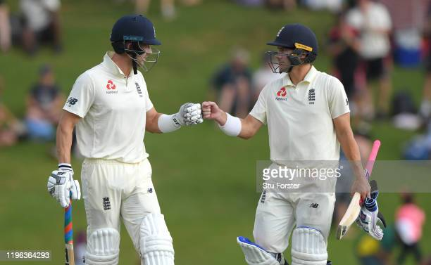England batsmen Joe Denly and Rory Burns touch gloves as play finishes for the day with both batsmen still at the crease after Day Three of the First...