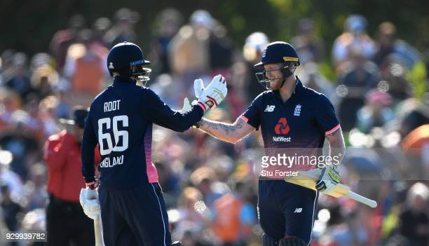 England batsmen Joe Root and Ben Stokes celebrate the winning runs during the 5th ODI between New Zealand and England at Hagley Oval on March 10 2018...