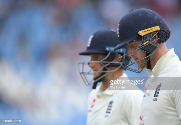 England batsmen Joe Root and Ben Stokes leave the field for lunch during Day Four of the First Test match between England and South Africa at...