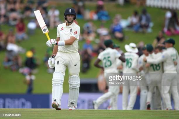 England batsmen Joe Root walks off after being dismissed by Anrich Nortje for 48 runs during Day Four of the First Test match between England and...