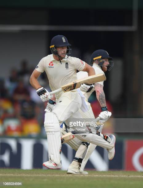 England batsmen Jos Buttler and Ben Stokes race between the wickets during Day Three of the Third Test match between Sri Lanka and England at...