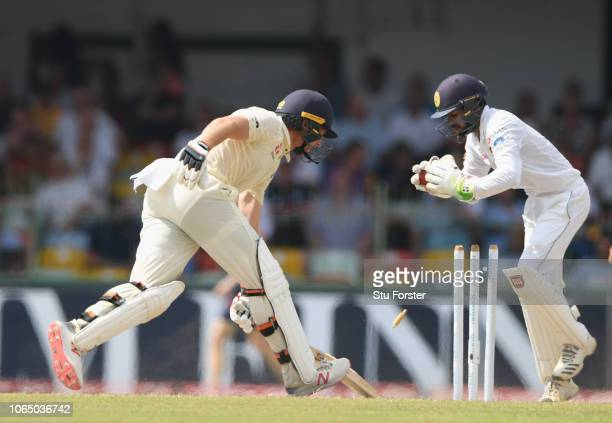 England batsmen Jos Buttler is stumped by Sri lanka keeper Niroshan Dickwella for 64 runs during Day Three of the Third Test match between Sri Lanka...