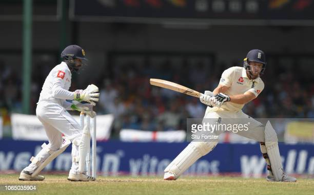 England batsmen Jos Buttler reverse sweeps for runs to reach his 50 during Day Three of the Third Test match between Sri Lanka and England at...