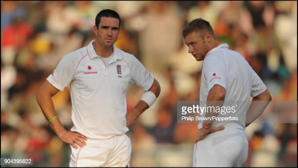 England batsmen Kevin Pietersen and Andrew Flintoff waiting to resume batting after a drinks break during the 2nd Test match between India and...