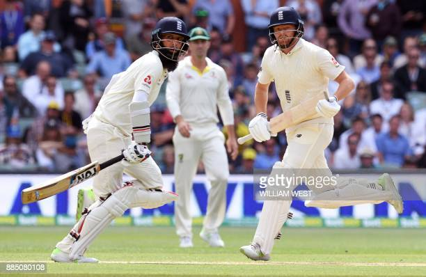 England batsmen Moeen Ali and Jonny Bairstow take more runs from the Australian bowling on the third day of the second Ashes cricket Test match in...
