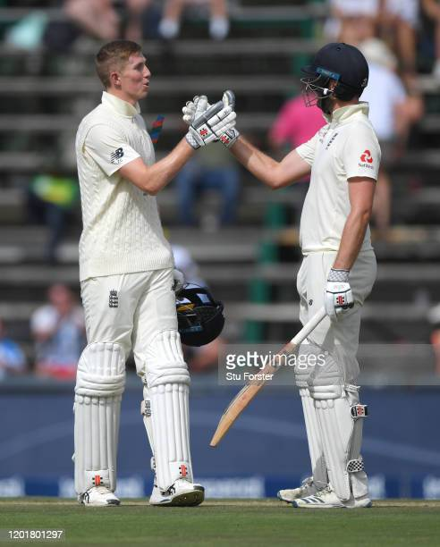 England batsmen Zac Crawley and Dom Sibley celebrate their 100 partnership during Day One of the Fourth Test between South Africa and England at The...