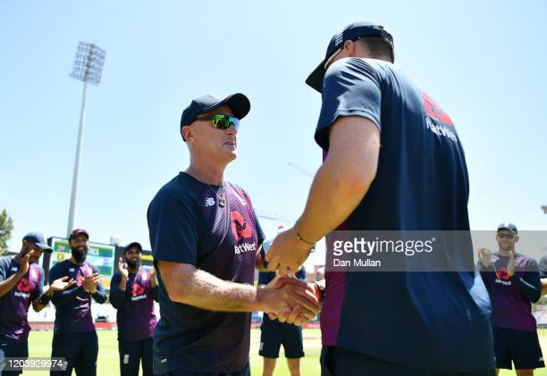 England batting coach Graham Thorpe presents Tom Banton of England with his cap prior to the First One Day International match between South Africa...