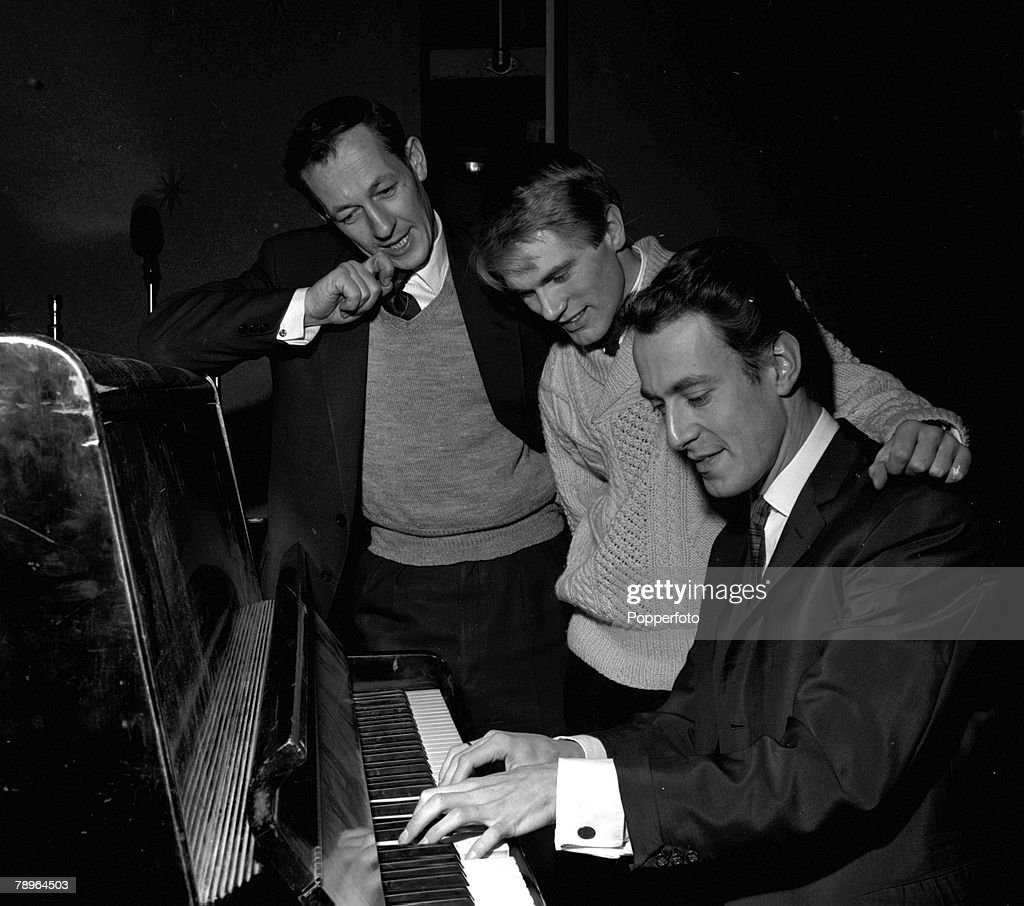 """England. 1961. BBC Producer Brian Matthew (left) is pictured with singer Adam Faith (centre) and musician and producer John Barry on """"Saturday Club"""". : News Photo"""