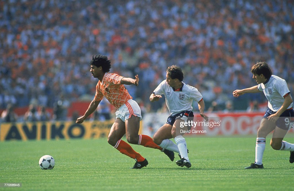 England beats Holland 0-1 during the European Championships in West Germany, 1988. Dutch player Frank Rijkaard is tracked by England's Kenny Sansom and Peter Beardsley.