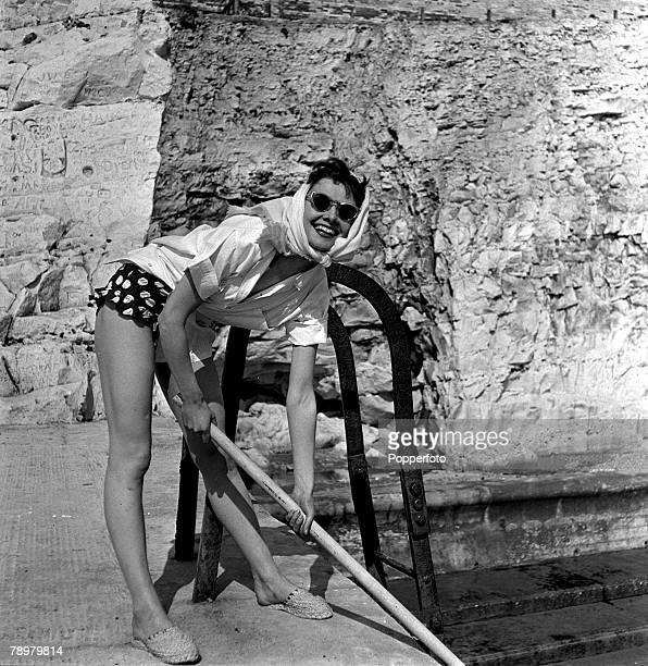 England Belgian born American film actress Audrey Hepburn pictured relaxing during a break in filming in Sussex England