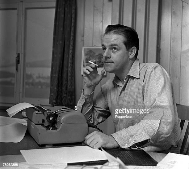 England Best selling mystery writer and author Alistair MacLean is pictured working on the typewriter at his home