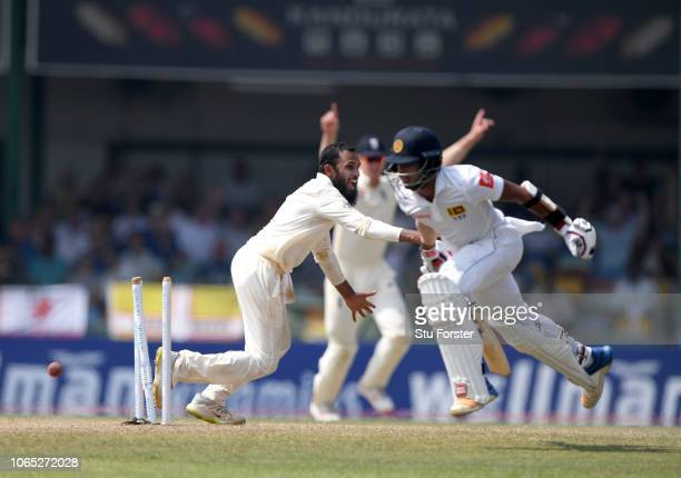 England bowler Adil Rashid celebrates after a direct throw from Jack Leach runs out Sri Lanka batsman Kusal Mendis during Day Four of the Third Test...