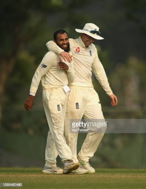 England bowler Adil Rashid celebrates with Joe Denley after taking the wicket of Silva during day one of the two day warm up match between a Sri...