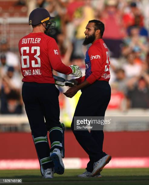 England bowler Adil Rashid is congratulated by Jos Buttler after taking his 4th wicket during the 3rd Vitality T20 match between England and Pakistan...