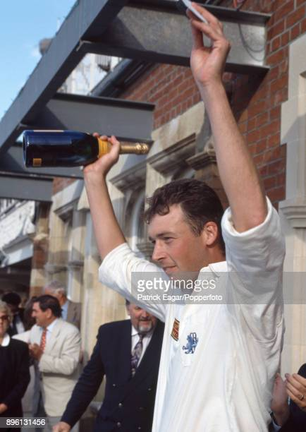 England bowler Angus Fraser celebrates after receiving his Man of the Match award at the end of the 6th Test match between England and Australia at...