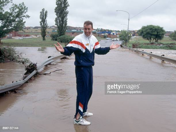 England bowler Angus Fraser stands in the flooded car park area of Centurion Park after heavy rain washed out the final three days of the 1st Test...