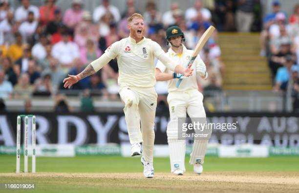England bowler Ben Stokes celebrates after dismissing Travis Head during day four of the First Specsavers Test Match between England and Australia at...