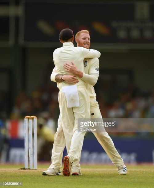 England bowler Ben Stokes celebrates with captain Joe Root after having Sri Lanka batsman Angelo Mathews caught in the deep by Stuart Broad during...