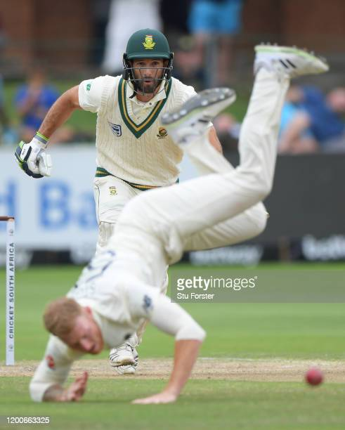 England bowler Ben Stokes dives in attempt to stop a drive from South Africa batsman Pieter Malan during Day Four of the Third Test between South...