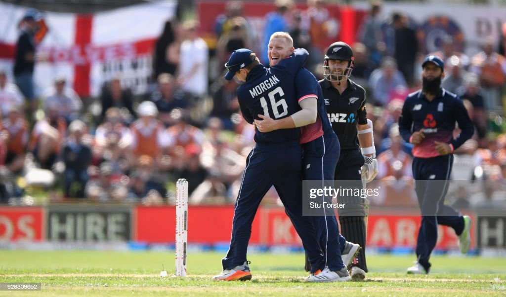 England bowler Ben Stokes is congratulated by Eoin Morgan after dismissing Kane Williamson during the 4th ODI between New Zealand and England at University of Otago Oval on March 7, 2018 in Dunedin, New Zealand.