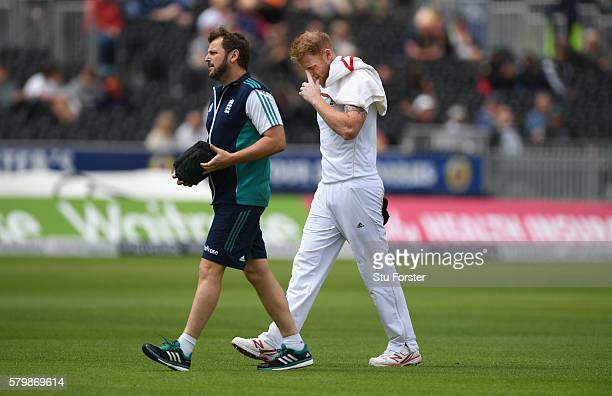 England bowler Ben Stokes leaves the field with an injury during day four of the 2nd Investec Test match between England and Pakistan at Old Trafford...