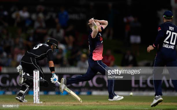 England bowler Ben Stokes reacts after narrowly missing running out Ross Taylor during the 1st ODI between New Zealand and England at Seddon Park on...