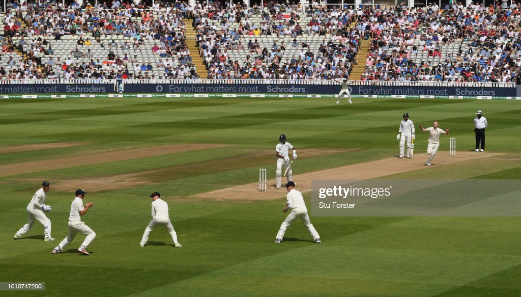 England bowler Ben Stokes takes the final wicket of India batsman Hardik Pandya caught by Alastair Cook (2nd l) during day 4 of the First Specsavers Test Match between England and India at Edgbaston on August 4, 2018 in Birmingham, England.