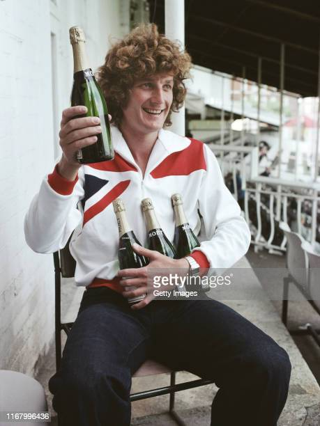 England bowler Bob Willis celebrates being the leading wickettaker of the 1977 Ashes Test series with an armful of champagne at the end of the 5th...